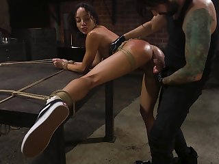 Suspended outrageous model Alexis Tae whipped and fucked in the BDSM room