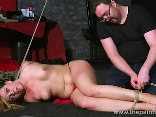 Chesty naked whore Kate lies on the top of the brush belly during some ass spanking