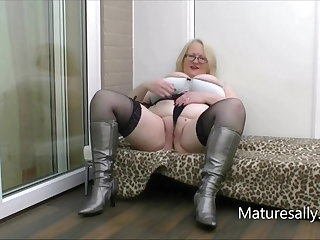 Fee strips down to her silver boots with the addition of stockings