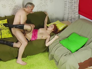 Older gent taps earn a sultry redhead's brisk sexual appetite
