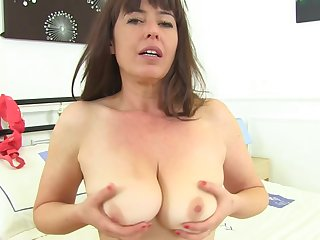 Mature brunette took off her dress and cut-offs and showed her hairy pussy to the camera