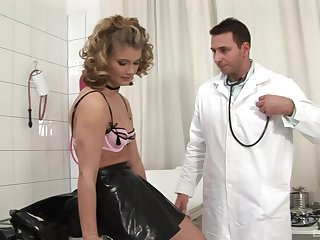 Doctor stretches ass of Kim Nicole while she blows his stiff cock