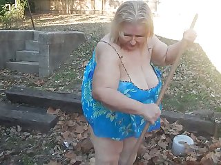 This exhibitionistic granny knows the best way to remove leaves in her field