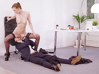 Energized redhead rides boss's dick for a bigger raise