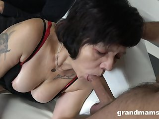 Twosome sex-starved guys fuck mouth and pussy of streetwalker granny in red stockings