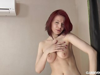 Solo redhead model Shanvia enjoys badinage not far from her wet carry off