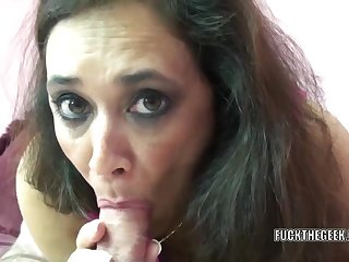 Mature swinger Alesia Pleasure lies on her vitals while she swallows a stiff cock