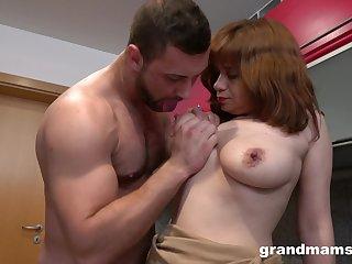 Stud smashes horny senior redhead on the cold kitchen amaze