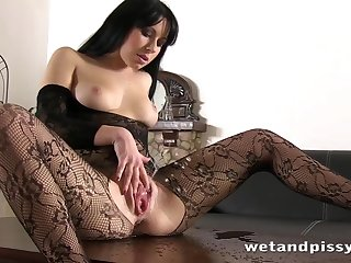 Amateur Czech chick in fabrication fishnets masturbates pussy and pisses